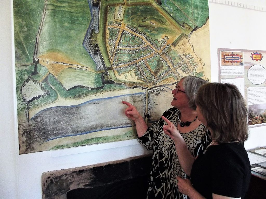 Kate kent and Catherine Seymour discuss a feature on the map