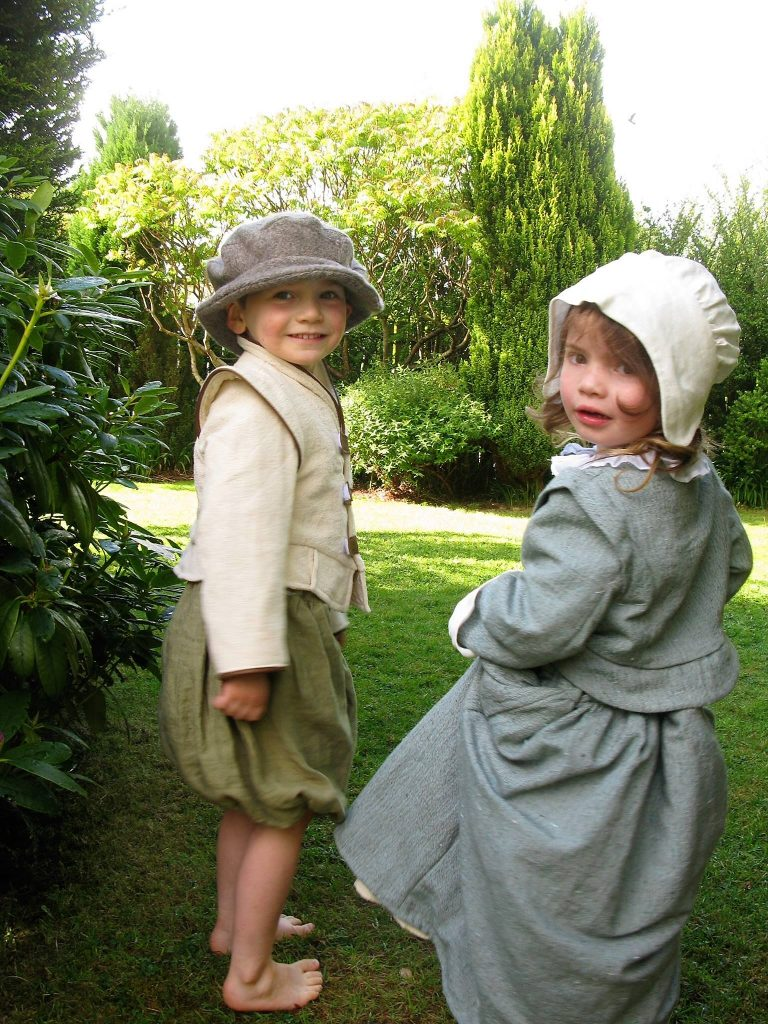 Young girl and boy in Elizabethan dressing up clothes